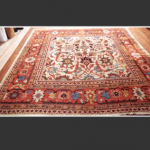 From the mid 19th-century onward, Persian Sultanabad rugs were exclusively made for the European market. They often favored the bold floral designs with spacious patterned Rugs. All rugs and carpets from this period were exclusively made with pure and natural dyes. Dark red, blue, soft green, gold, and ivory are the typical colors. Warps, foundation, and wefts are cotton and the pile is wool. The wool of the Sultanabad rugs is hand spun usually from the weavers own sheep. The rugs are woven using asymmetrical Turkish knots to tie each loop one by one. Besides using wide and bold borders, Sultanabad rugs had designs based on small repeating floral patterns as well as all-over large scale lattice vine patterns. Sultana bad rug designers simplified the designs by creating a special work of art with unique character. Foreign companies as well as local merchants adopted a similar system, causing Sultanabad carpets to become carpets of the highest decorative value, even today by both interior designers and the discriminating collector. Therefore, Sultananads have great value in any condition, often favored for their bold floral designs with spacious patterns.