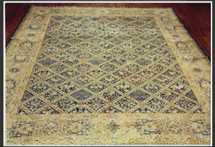 The more modern designs mainly developed for the Western market in the late 19th century are either Aubussons or Koran (Quran) medallion-and-corners with an open field. The open field is actually an important distinguishing characteristic of these modern Kerman rugs. The tradition Kerman designs consist of Shah Abbasi medallion-and-corner, all-over floral, all-over botch, striped designs, paneled garden, tera-of-life, prayer, vase, garden, hunting, animal, and the famous elaborate pictorials using both Persian and European themes. Usually 15 to 30 colors are used in one rug. The two most common colors use in Antique and semi-antique rugs are rich red and red-blue. More recent rugs tend to have pastel colors such as lime green, pink, ivory and grey-blue. Turquoise, orange, champagne and beige are also among the commonly used colors. Kerman rugs are woven with asymmetric (Persian) knot.